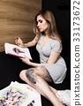 Artist painting in her workshop 33173672