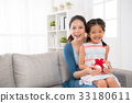girl children and mother hold mother's day gift 33180611