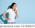 slender lady painful eating fresh milk ice cream 33180624