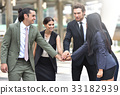 Business team with their hands together. 33182939