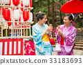 japanese women going to the local shrine 33183693