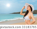 bikini woman wearing white sun hat looking shine 33183765