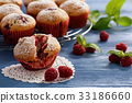 Sweet homemade raspberry muffins on wooden table. 33186660
