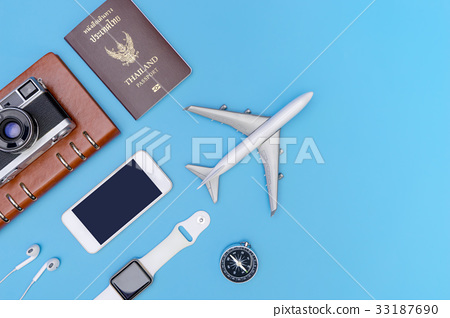 Travel object and accessories on blue copy space 33187690
