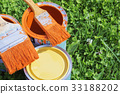 Paint cans, brushes, bright orange color 33188202