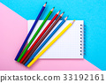 Notepad for notes and colorful pencils on colored 33192161