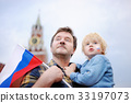 man and his little son with russian flag 33197073