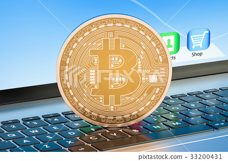 Bitcoin mining concept on laptop keyboard 33200431