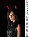 Halloween woman portrait in studio 33205484