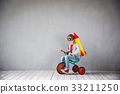 Kid playing with jet pack at home 33211250
