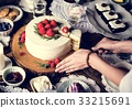 Woman cutting sweet cake to share for the party 33215691