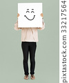 Woman holding banner with smiley face 33217564