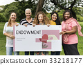 Group of women holding banner of charity donations campaign 33218177