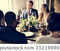 Bride and Groom Clinging Wineglasses with Friends on Wedding Rec 33219000