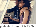Couple Driving a Car Traveling on Road Trip Together 33219268