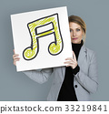 Woman holding placard with music note icon 33219841