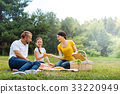 Happy young family having a picnic in the park 33220949