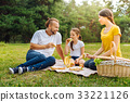 Pleasant family having sandwiches on picnic 33221126