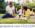 Adorable girl showing a puzzle to her father 33221299