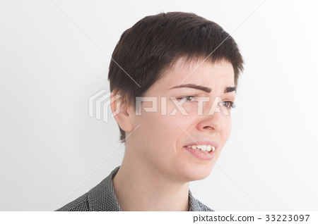 A strong image of a very upset and emotional woman 33223097