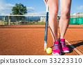 Female legs with tennis racket 33223310