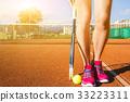 Female legs with tennis racket 33223311