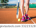 Female legs with tennis racket 33223328