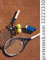 Tennis balls and rackets on the court 33223330