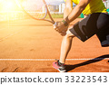Male hand with tennis racket 33223543