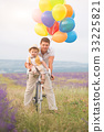 Father and son playing with balloons on lavender 33225821