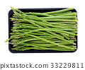 asparagus in black plastic tray on a white 33229811