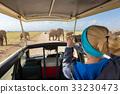 Woman taking photos on african wildlife safari 33230473