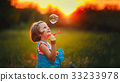 Five years old caucasian child girl blowing soap 33233978