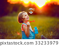 Five years old caucasian child girl blowing soap 33233979