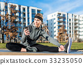 Active young woman checking her mobile phone 33235050