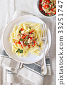Italian pasta with tuna, red pepper and capers 33251747