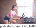 woman use exercise bike 33254609