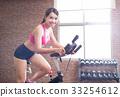 woman use exercise bike 33254612