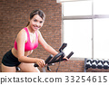 woman use exercise bike 33254615