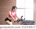 woman use exercise bike 33254617