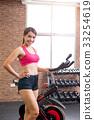 woman use exercise bike 33254619