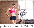 woman use exercise bike 33254620