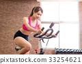 woman use exercise bike 33254621