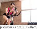 woman use exercise bike 33254625