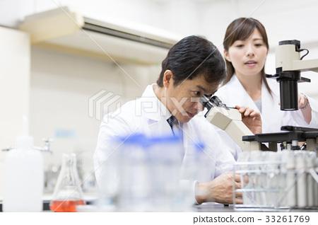 microscope person researching stock photo 33261769 pixta