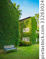 Vintage House Covered by Green Ivy in the park 33263024
