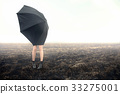 girl with umbrella on black field 33275001
