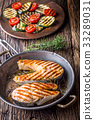 Salmon. Grilled  salmon steak in roasted pan. 33289031
