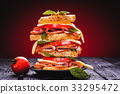 Club sandwich with cheese,basil, tomato, ham 33295472