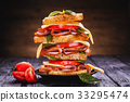 Club sandwich with cheese,basil, tomato, ham 33295474